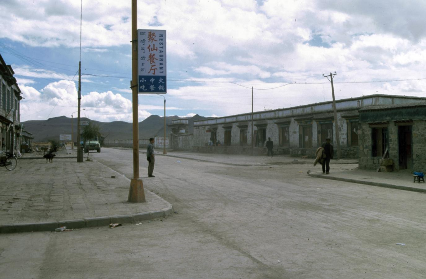 man-crossing-the-street-gyantse-tibet-2000