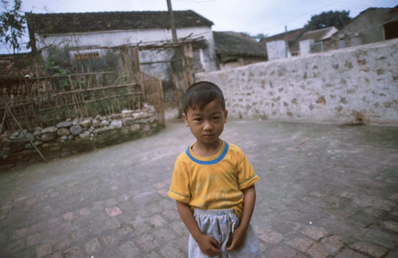 small-boy-outside-his-grandfather's-house